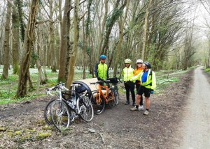 Cyclists in a woodland glade on the Cuckoo Trail