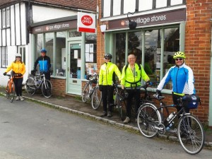 Cyclists outside Ripe Village Stores