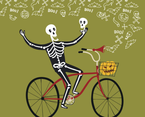HAlloween skeleton on a bike.